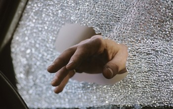 burglars_hand_through_a_car_window__default