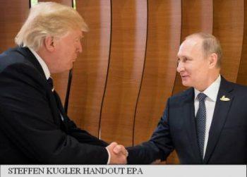 Prima strângere de mână Trump - Putin
