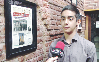 David Racovan, elev de 13 ani, a venit din SUA să facă practică la Informaţia Zilei